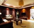 客廳設計,沙發組合,茶幾,電視柜,裝飾畫,吊燈