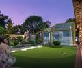 草坪,阳光房,围墙,假山,庭院景观