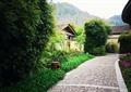 園林景觀,碎石鋪裝,垃圾桶,高層,花卉植物,竹林,建筑,度假景觀